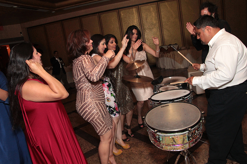 man playing drums and girls dancing in events