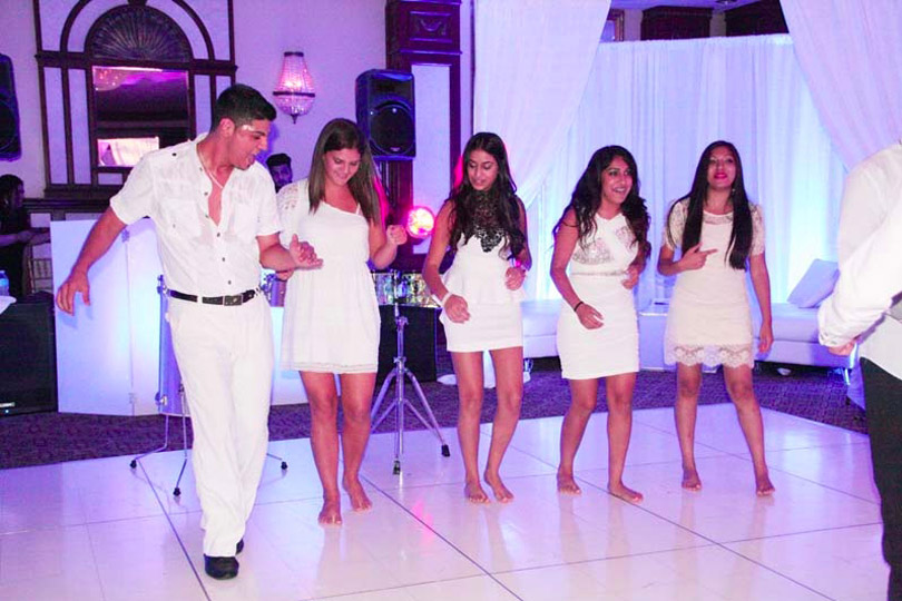 man dancing with girls in event